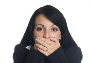businesswoman in the Speak No Evil pose.